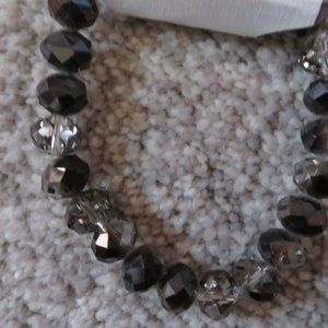 BLACK AND SMOKE COLORED BEADED BRACELET